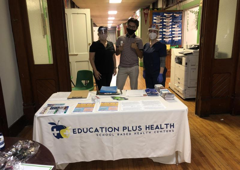 A team prepared for community flu vaccination clinics at Deep Roots Charter School.