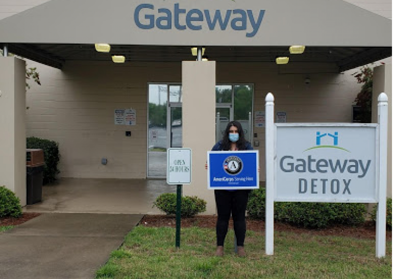NHC member Roya stands outside the entrance to the Gateway Detox Building.